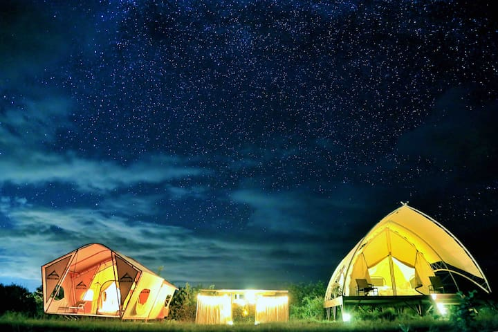 The white tent on the right is tent Aries.