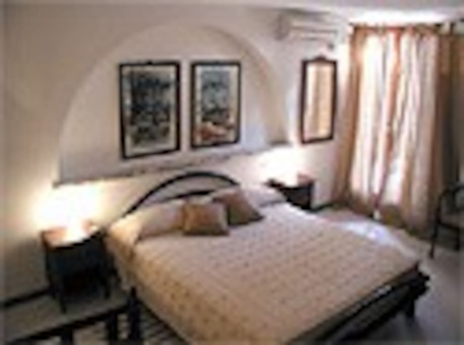 Una delle camere di Villa Acero