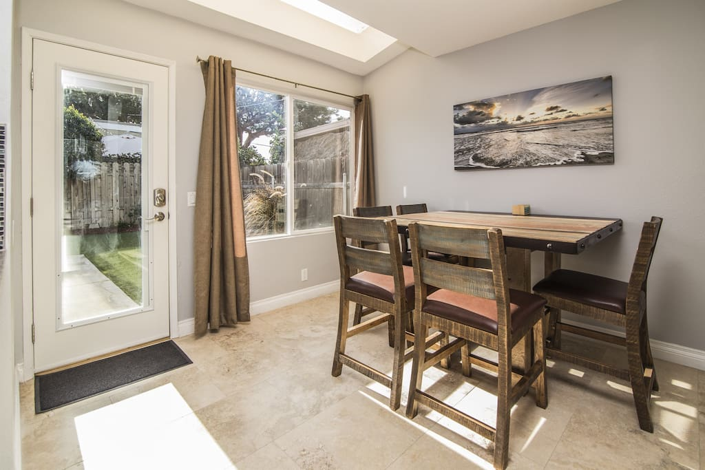 Dining table off kitchen overlooks the backyard and seats 6