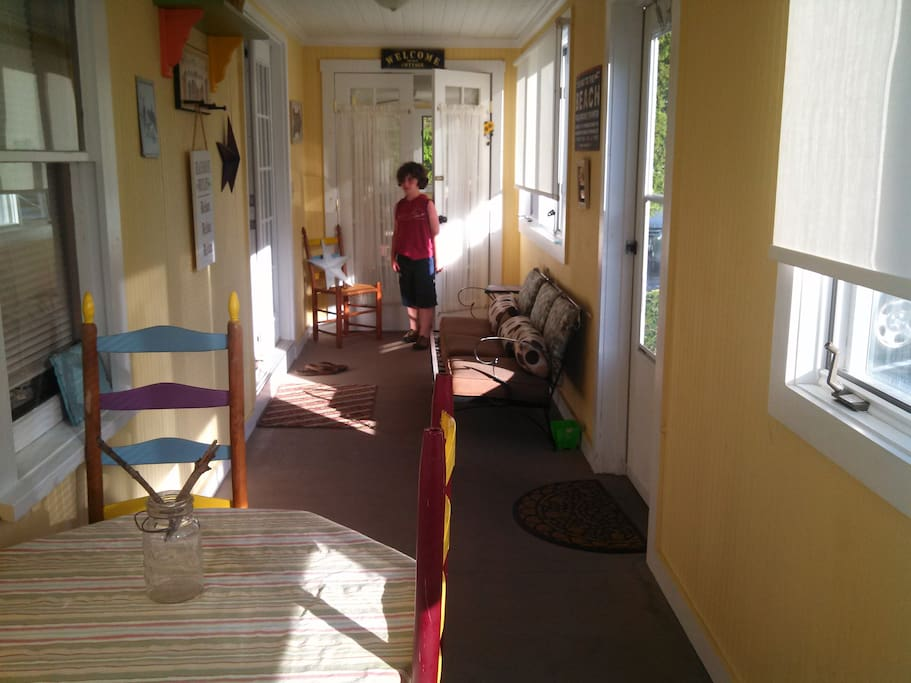 Opening the doors to expand or divide the sunny, enclosed  porch.