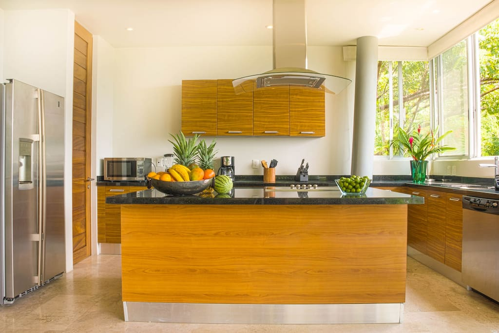 The kitchens has all the modern conveniences you need and the large, bright windows make it a pleasure to spend time there with sweeping ocean and jungle views.
