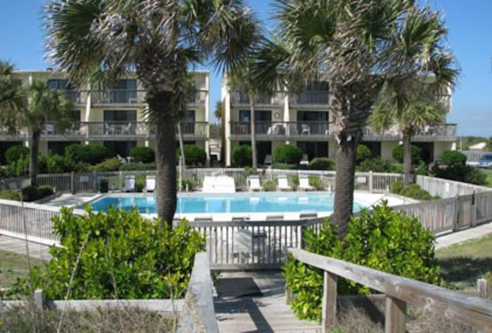 Villa E-1 is directly behind the pool and looks out on pool and gulf beach.