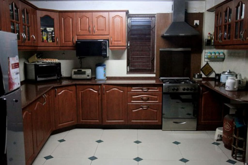 Modern kitchen with gas oven, toaster, microwave, freezer