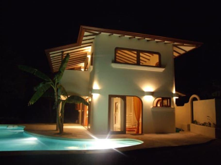 House and pool and shower corner by night