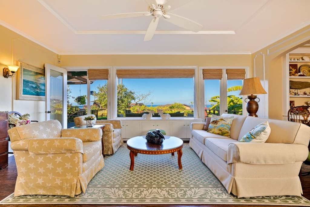 Sweeping ocean views from the charming living room, which opens up onto the deck.