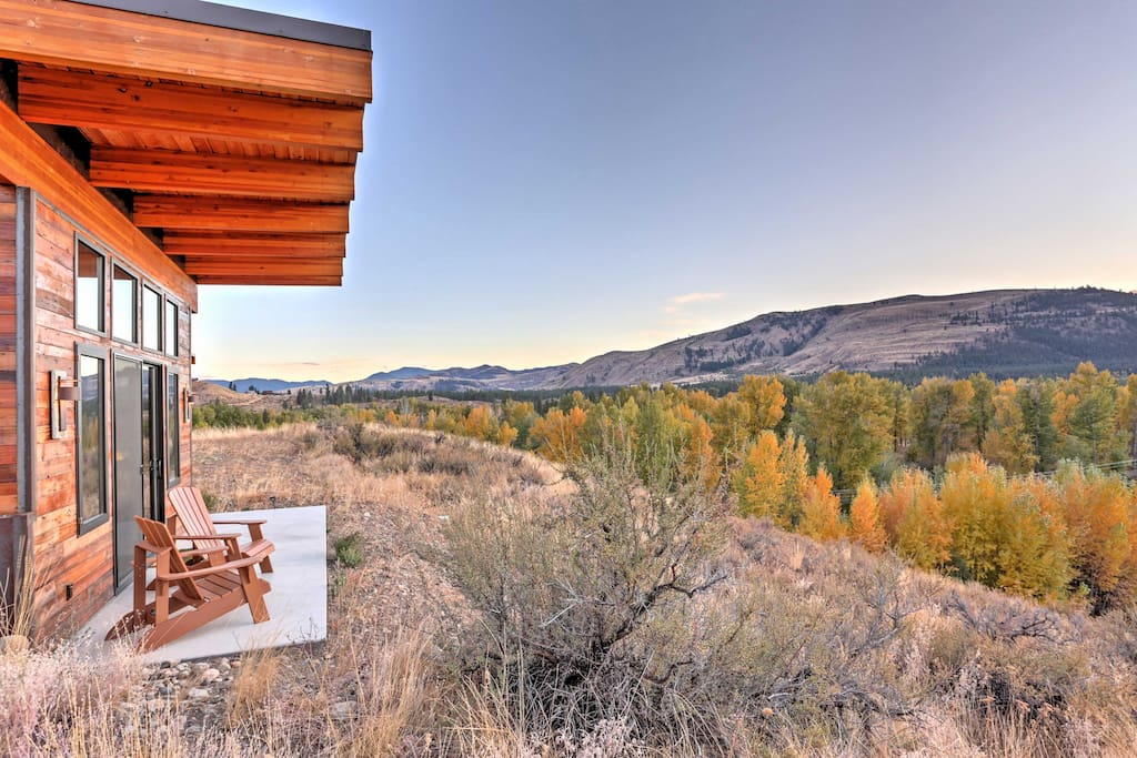 Surrounded by mountain views, this architecturally modern home offers plenty of outdoor space to enjoy the views.