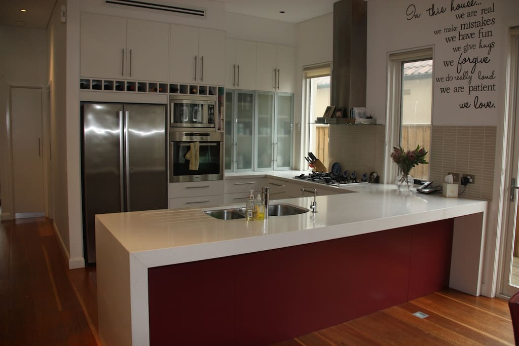 Kitchen include fridge, oven, gas top, microwave and filtered water tap.