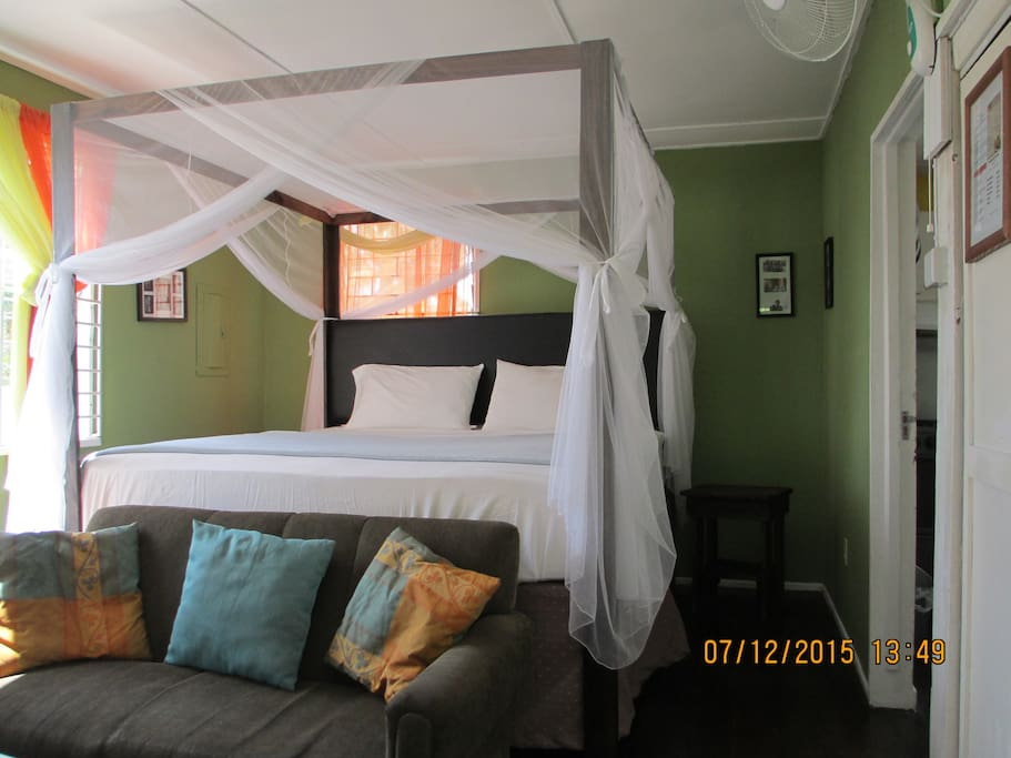Deluxe room sleeps 2 person on king size pillow top 4 posted netted bed