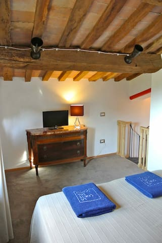 The bedroom of the Black Mulberry Tree apt.