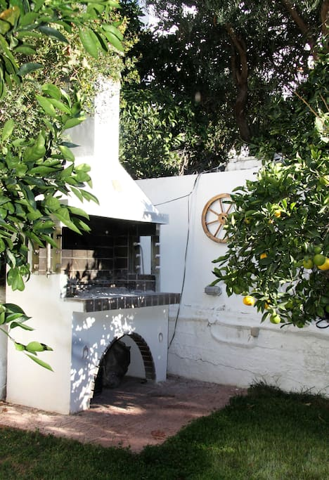Barbeque corner for the guests in the orange tree garden in Tolo