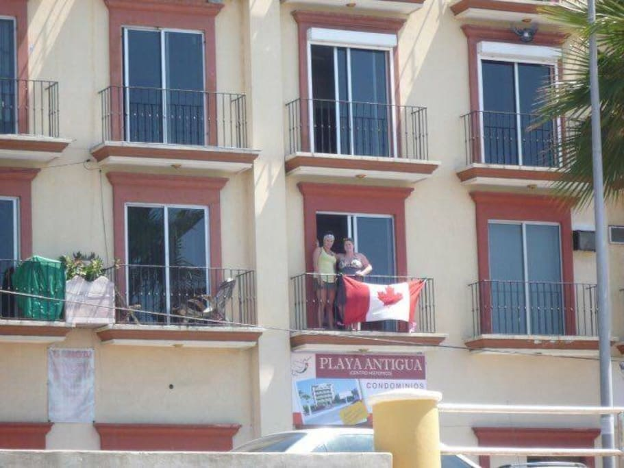 The apartment is on the 2nd floor (with the Canada Flag) and has two balconies.  First from the living room and the other from the Master bedroom.