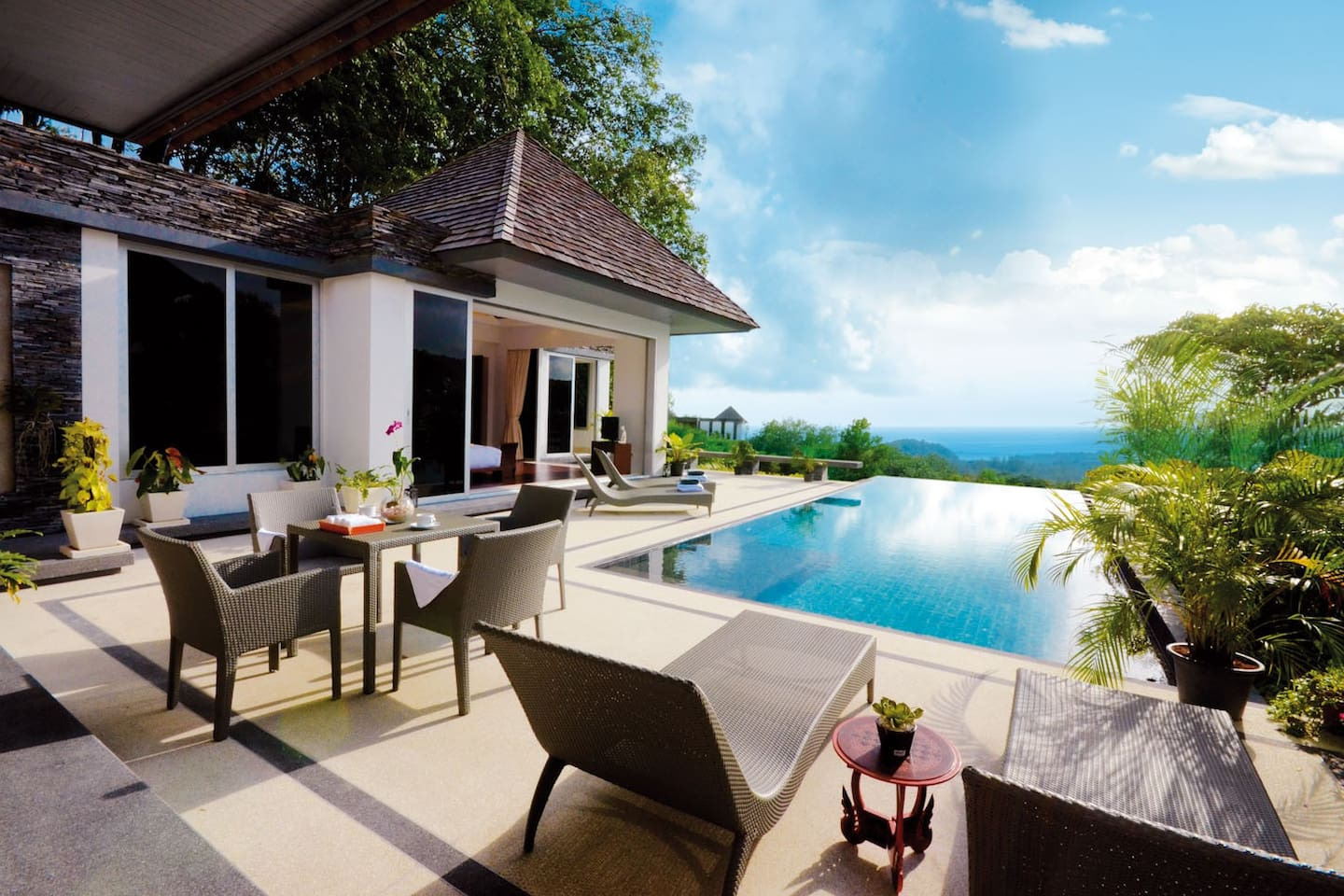 Open pool area with a pack of furniture