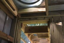 Here's another good view of the ladder hole with the cool window. The hatch closes right on top of the hole to keep you safe from nighttime falls and intruders. The entrance is about 24 inches across, so measure your waist if you're pregnant!