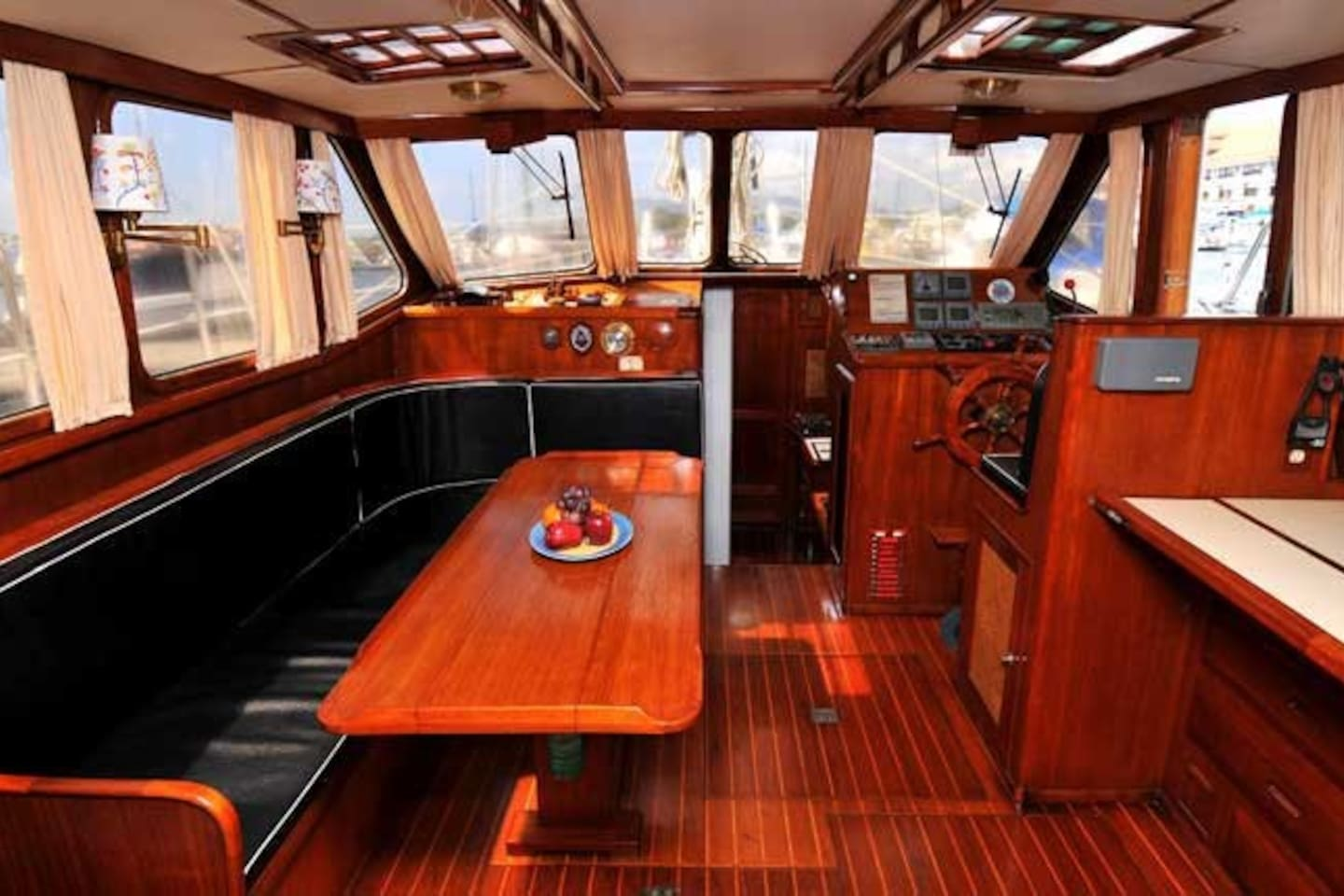 "RJM's roomy salon is bright with 270 degree visibility through the large ""Pilot House"" windows"