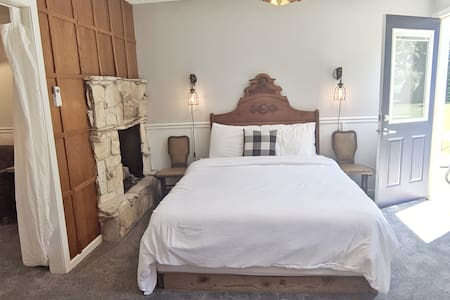 The Farmhouse Suite at the Hop & Vine Inn has its own patio, along with a queen bed, twin bed, sofa sleeper, and full bathroom with tub.
