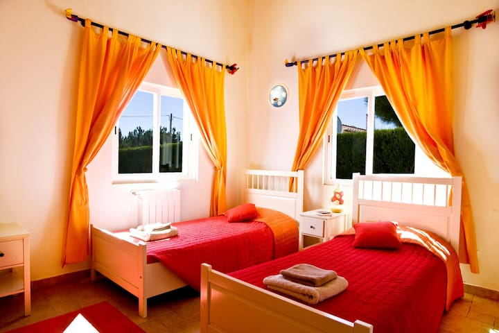 Bedroom 3 with 2 single beds and an en suite bathroom