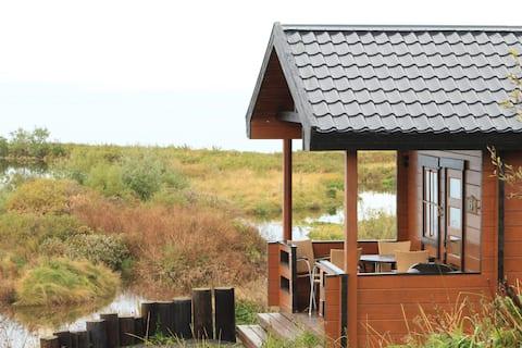 2 bedroom cottage cuddled into nature of Húsavík