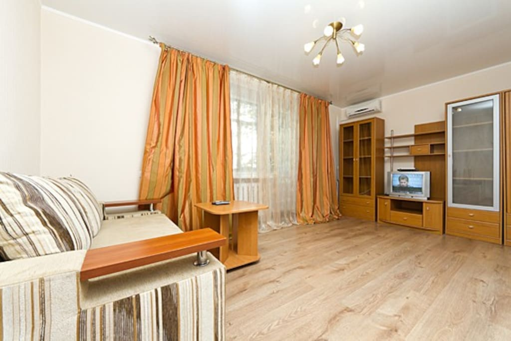 Living room with balcony. Sofa, TV (now there are flat screen TV), coffe table, airconditioner and free Wi-Fi.