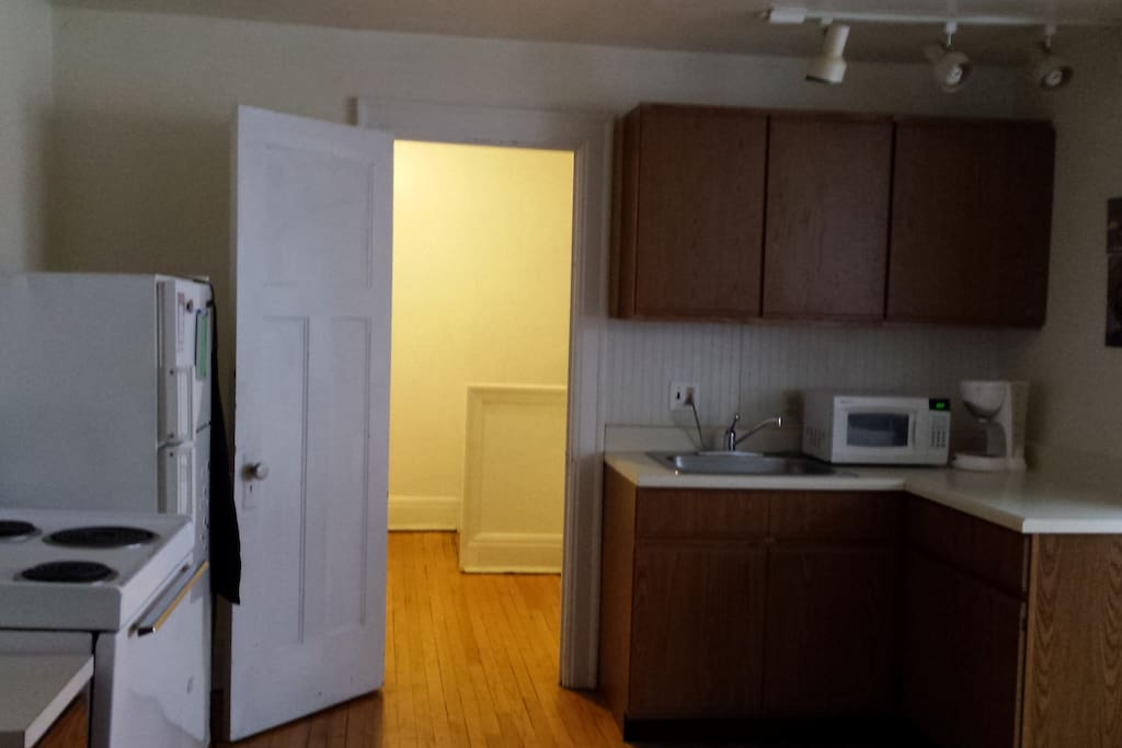 Full kitchen with micro-wave, frig, stove/oven, cabinets