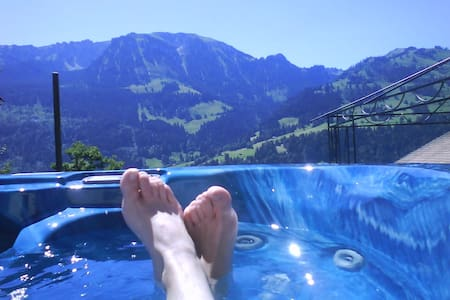 Unique view from the whirlpool - Weissenburg - Apartment