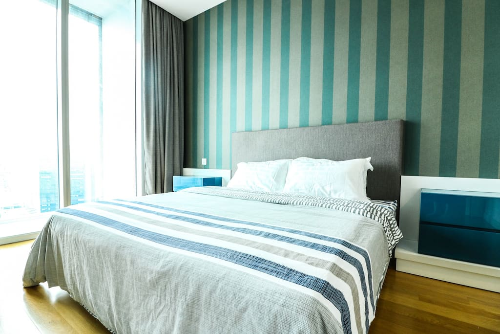 Master bedroom with a King size bed soothing and air-cond along with a breath taking city view