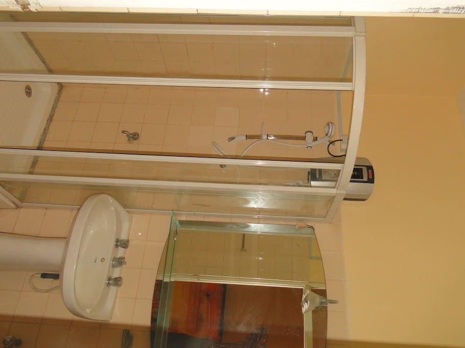 Bathroom with hot water shower and cubical
