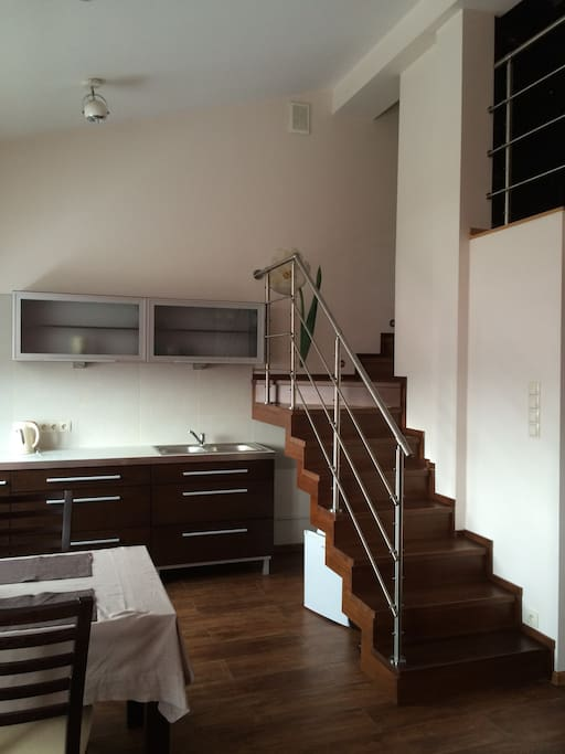 Kitchen + stairs to entresol