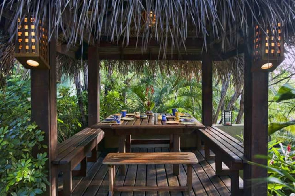 "Outdoor ""breakfast palapa"" by the gardens and water feature."