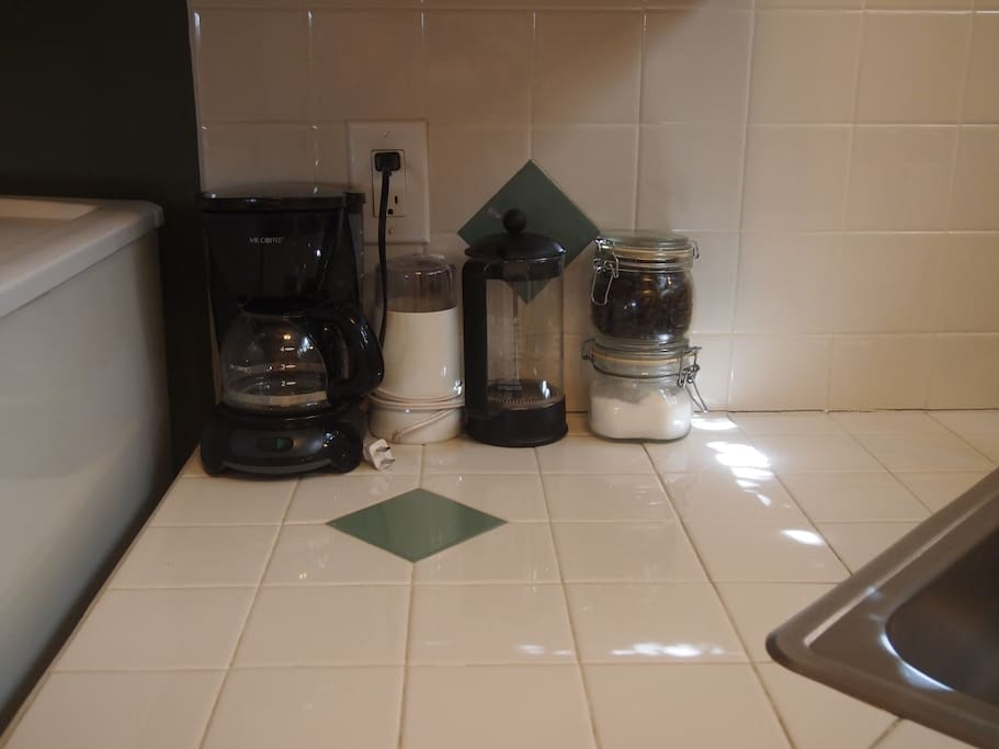 Locally roasted coffee beans, French press, drip pot, and tea offerings for you...