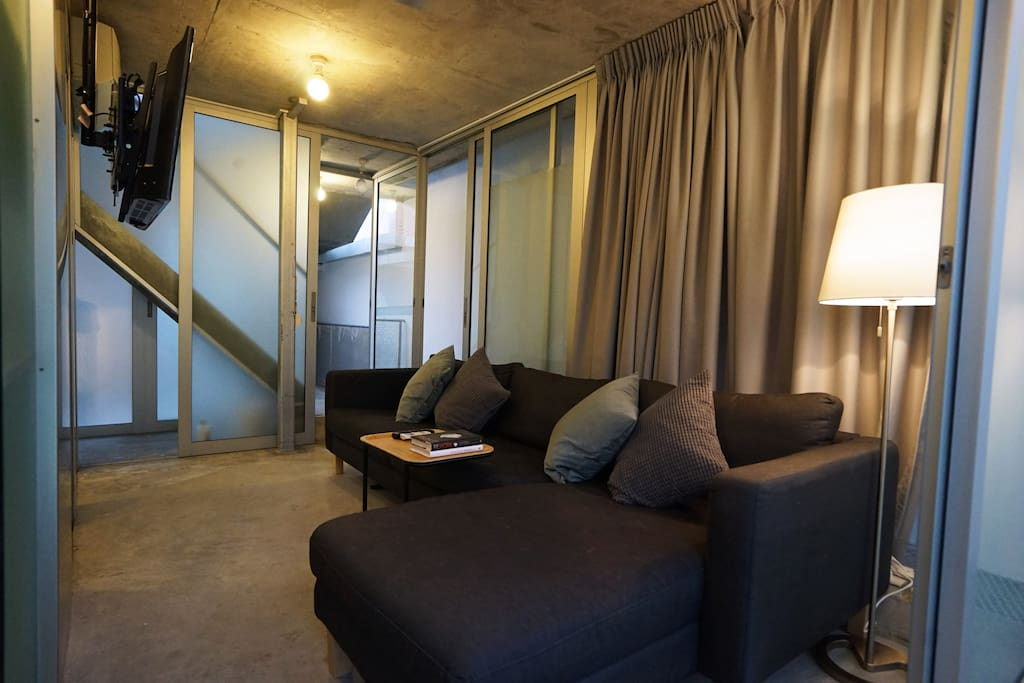 "Peter (Review) ""Thumbs up for the creative design of this BnB, an unusual but funky layout. The rooms are not big, but well laid out. ""   Sapporo Loft first level: Big and comfortable sofa that sleeps 2 people!"