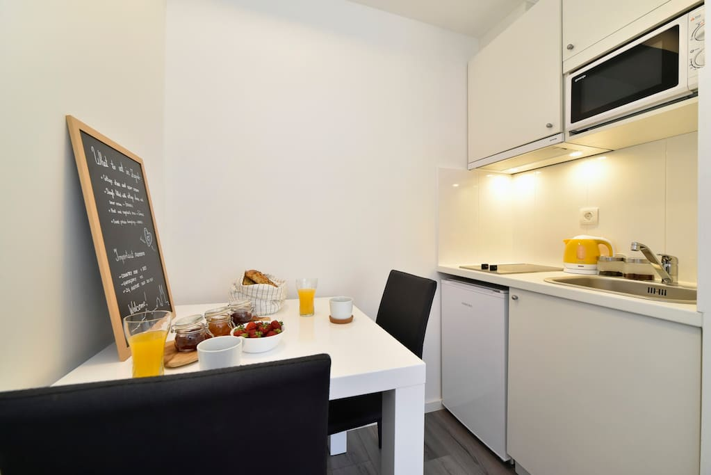 fully equipped kitchenette with with adjoined dining area