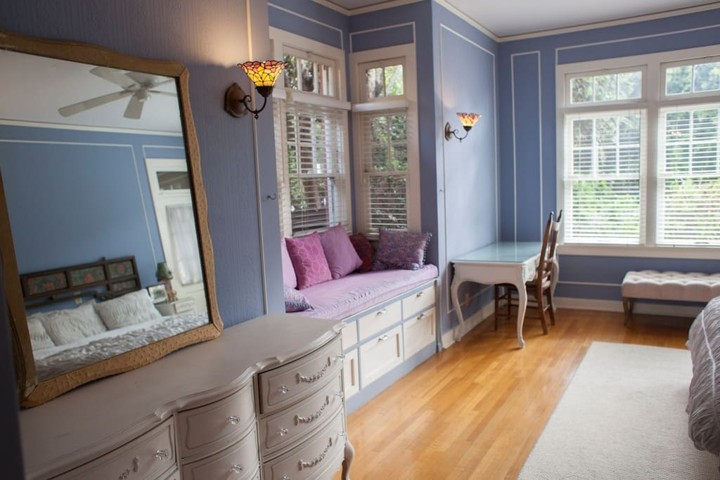 Chest of drawers and window seat in bedroom