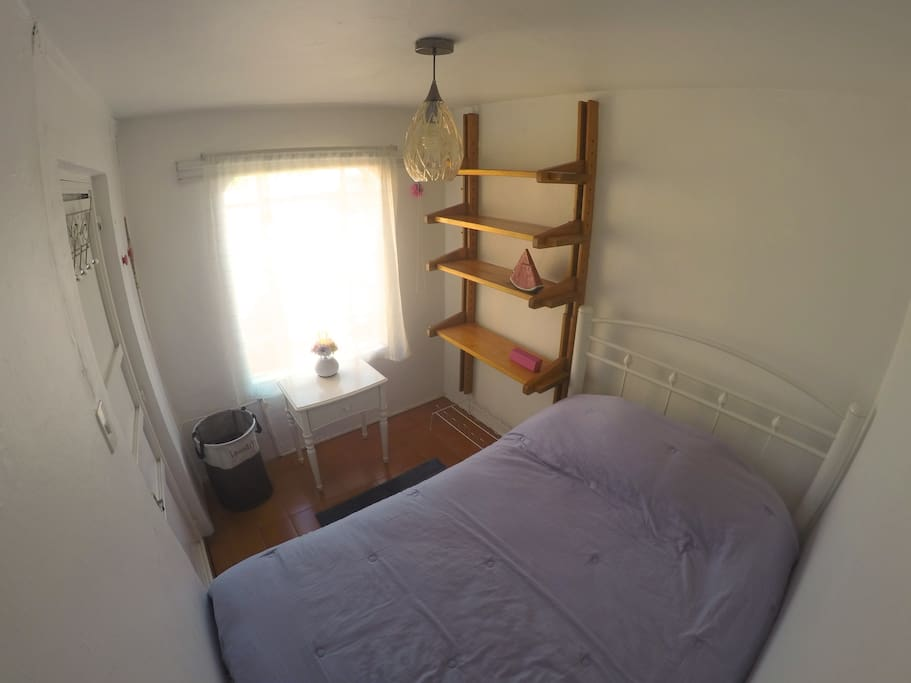 Room includes shelfs and laundry basket