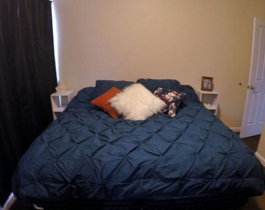 Comfy and cozy king size bed in the master bedroom.