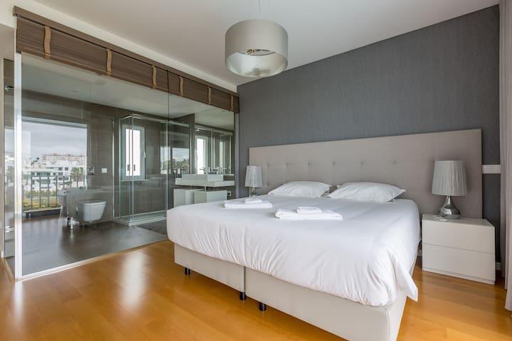 Modern King size bedroom with open window bathroom