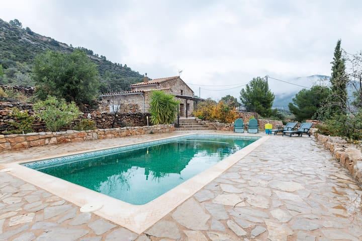 A beautifully restored farmhouse with a private pool in the mountains