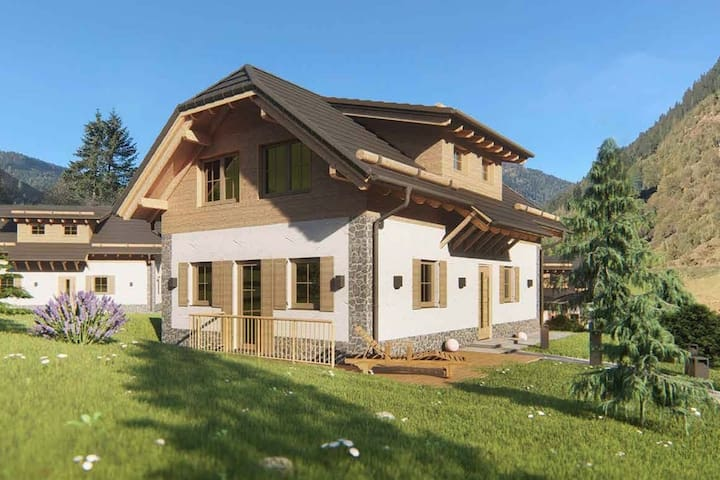 Modern detached chalet with private sauna, unobstructed view and 2 km from the ski lift.