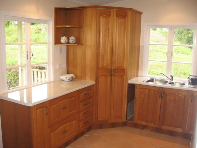 Light, spacious and fully equipped kitchen, looks out on to the deck