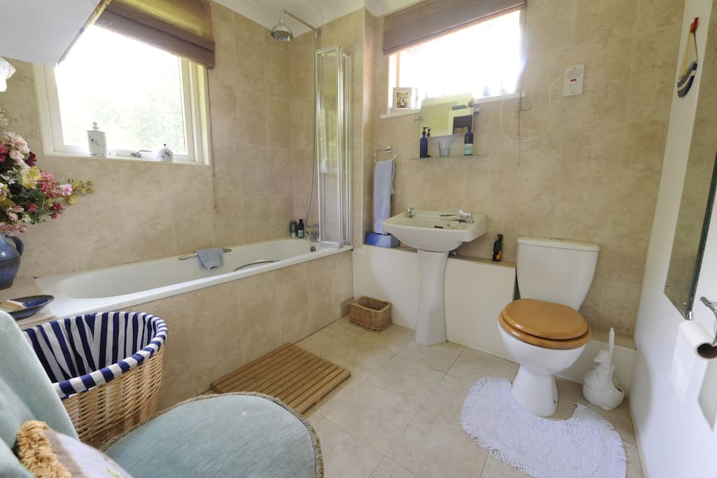 En suite bathroom adjoining the twin bedded room 4(with bath and shower).