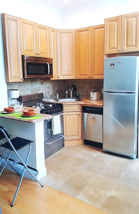 Renovated kitchen with all the appliances to prepare you meals