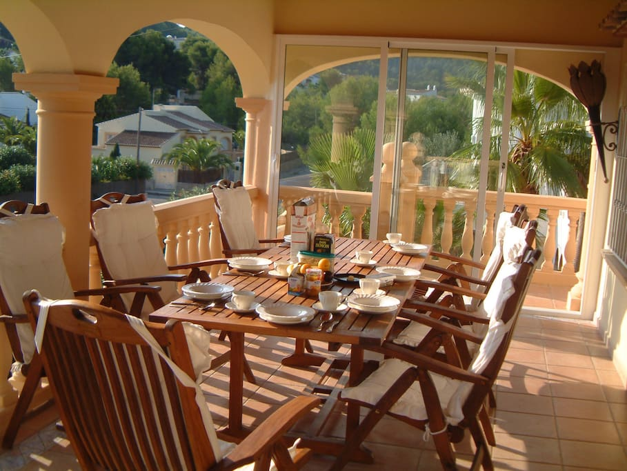 Breakfast on the upstairs terrace with sea view in the distance.