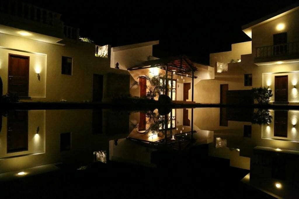 Reflection of the villa seen in the pool at night