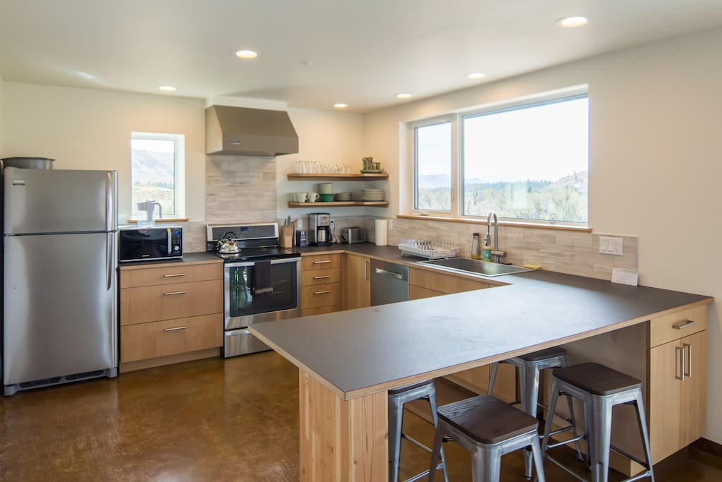 Kitchen with Paperstone countertops and island seating for four