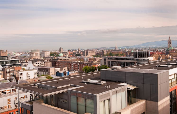 view from living room over temple bar and the four courts to the Wicklow Mountains beyond