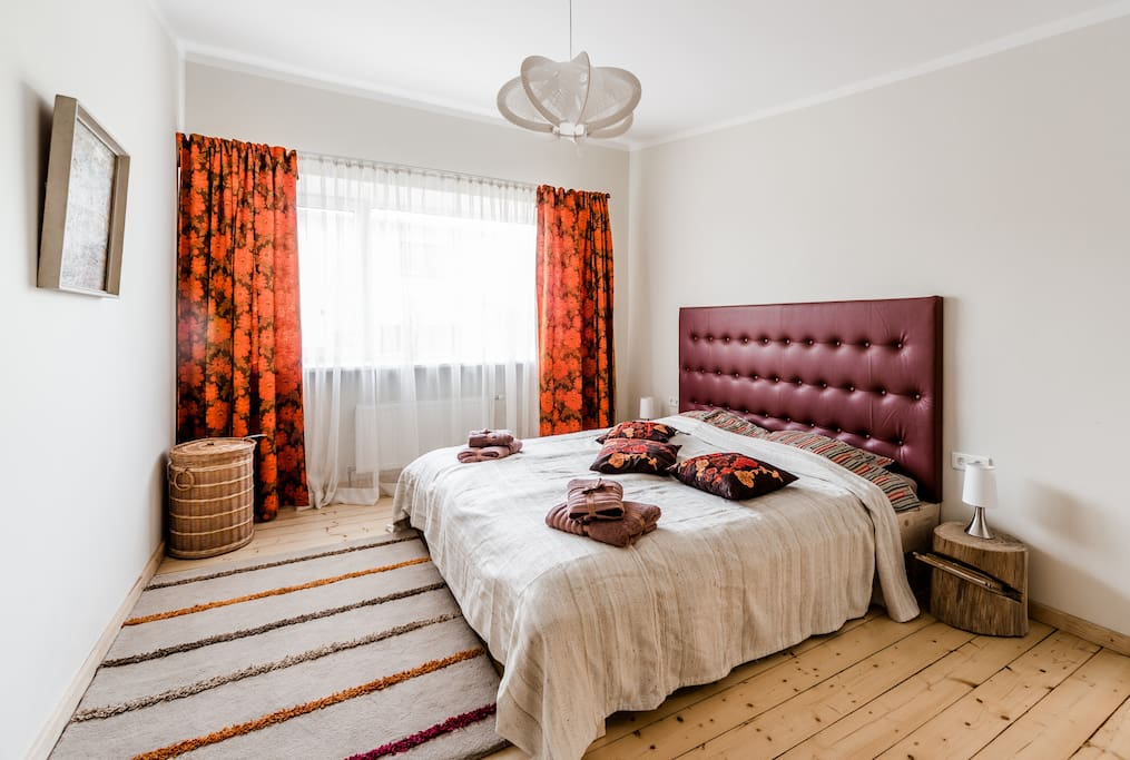 One of the double rooms - bright and with natural colors