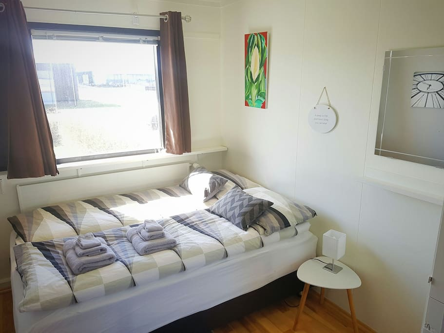 The bedroom has a good quality queen size bed with comfortable duvets and pillows to help make sure a good night's rest.