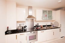 Kitchen with dishwasher washing achine and nespresso coffee maker all for guests use