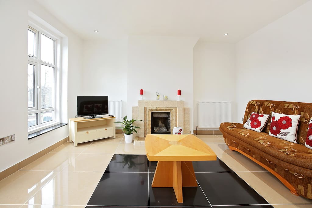 Bright and spacious living room with a double sofa bed.too