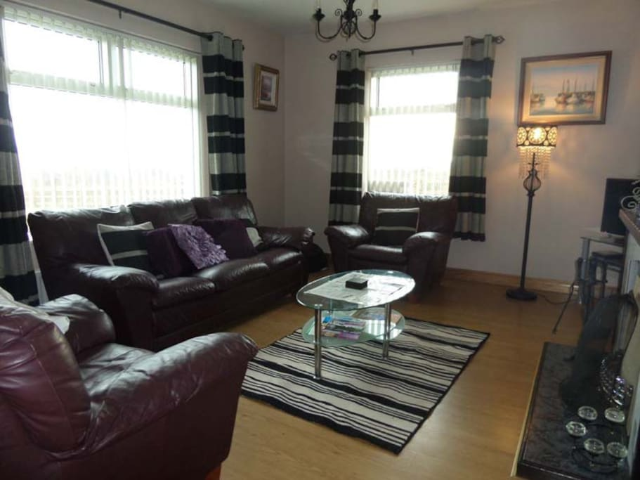 Living Room with Leather suite, flat-screen TV, DVD and Seaviews