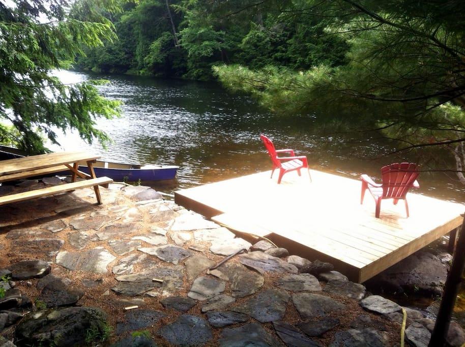 Flagstone deck and cedar dock at river's edge